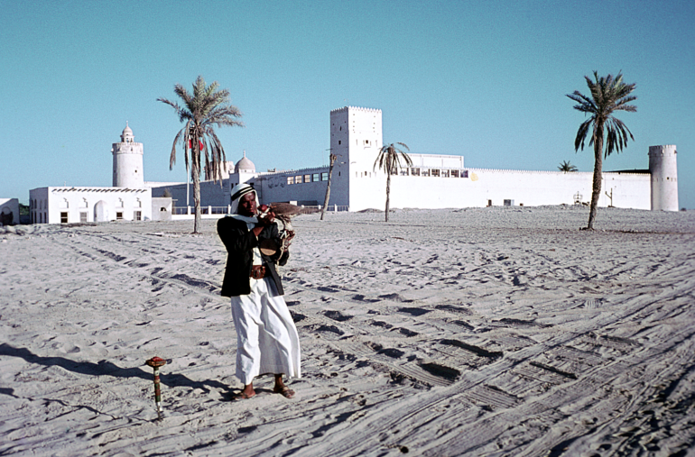 This 1960s photograph shows a falconer in front of Qasr Al-Hosn. The photograph is from the Colonel Edward