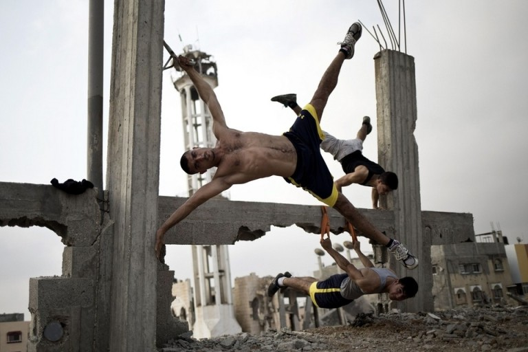 In Gaza City, street workout is more than just a form of exercise, it is a way for Palestinians to reclaim their city, even if it is in ruins. Mohammed Abed / AFP