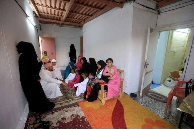 Salima Ali Al Farsi, seated right, with her children and grandchildren in their home in Abu Dhabi, which dates from about 1969 and is one of the oldest houses in the city. Ravindranath K | The National