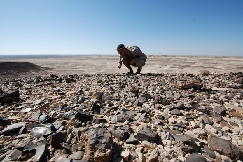 Dr Yamandú Hilbert examining stone tools from a Palaeolithic site on the Nejd Plateau, Dhofar. Courtesy Jeffrey Rose