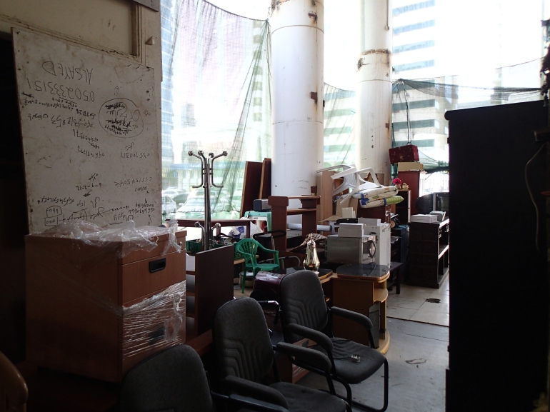 The salvage ranges from window frames and old wardrobes to filthy mattresses and former tenants' personal effects.