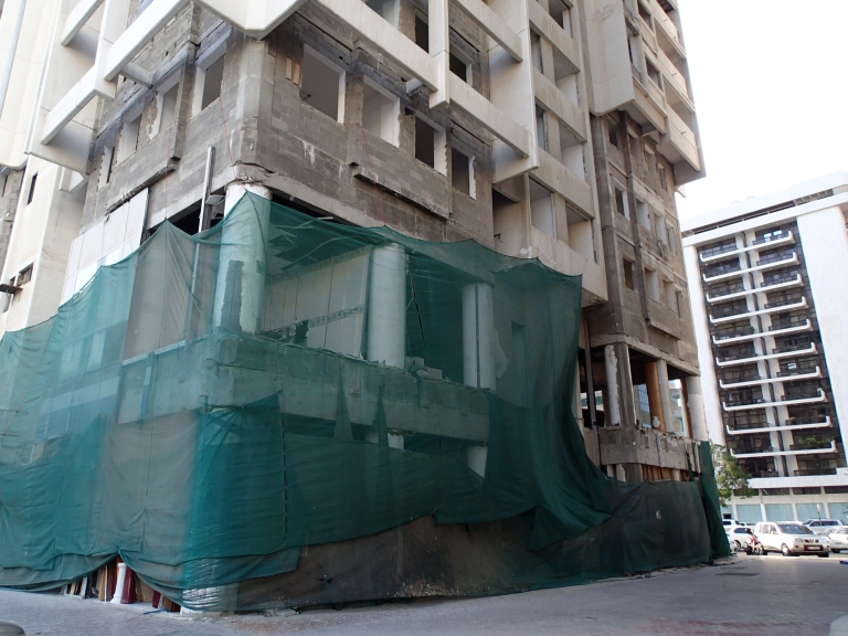 A derelict block in downtown Abu Dhabi awaits demolition.