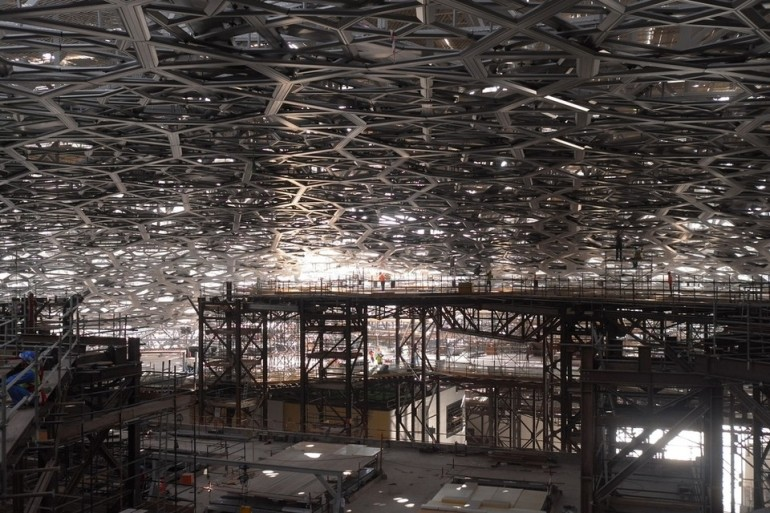 Made of aluminium and stainless steel, the largest of Louvre Abu Dhabi's stars measure 13 metres in diameter, weigh 1.3 tonnes, and join to form a constellation that weighs 2,000 tonnes. James Langton / The National